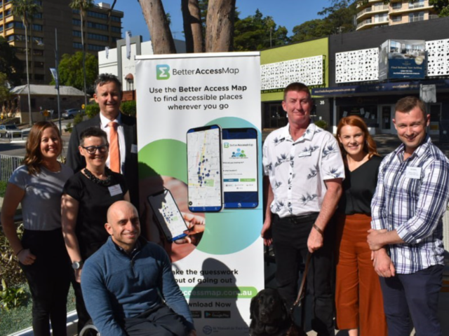 Blog1_Vinnies_staff_and_supporters_standing_in_front_of_a_Better_Access_Map_banner_in_Gosford.png