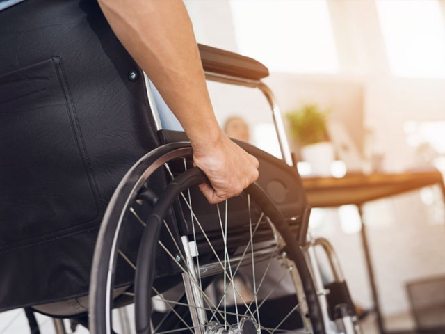 Blog_11_Persons_hand_on_wheelchair_wheel.png